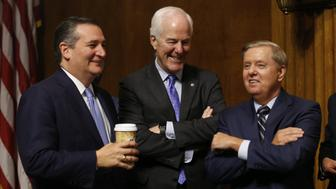 WASHINGTON, DC - SEPTEMBER 27:  Republican Senators Ted Cruz (L), John Cornyn (C), and Lindsey Graham (R) chat during a break in the hearing on the nomination of Brett Kavanaugh to be an associate justice of the Supreme Court of the United States, on Capitol Hill September 27, 2018 in Washington, DC. A professor at Palo Alto University and a research psychologist at the Stanford University School of Medicine, Ford has accused Supreme Court nominee Judge Brett Kavanaugh of sexually assaulting her during a party in 1982 when they were high school students in suburban Maryland. (Photo By Michael Reynolds-Pool/Getty Images)