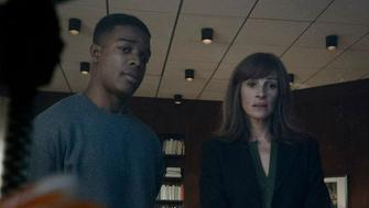 "Stephan James and Julia Roberts in ""Homecoming."""