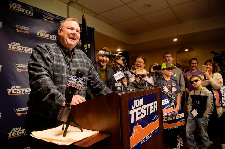 Sen. Jon Tester, surrounded by family and supporters, announces his victory Wednesday in Great Falls, Montana.