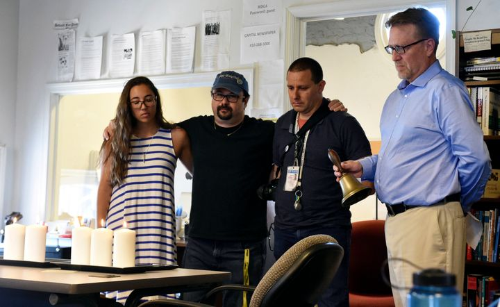 Rick Hutzell, right, the editor of The Capital Gazette, is joined by reporter Selene San Felice and photojournalists Paul W.
