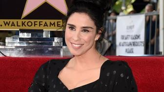 Actress/comedian Sarah Silverman poses atop her new star on the Hollywood Walk of Fame following a ceremony in her honor on Friday, Nov. 9, 2018, in Los Angeles. (Photo by Chris Pizzello/Invision/AP)