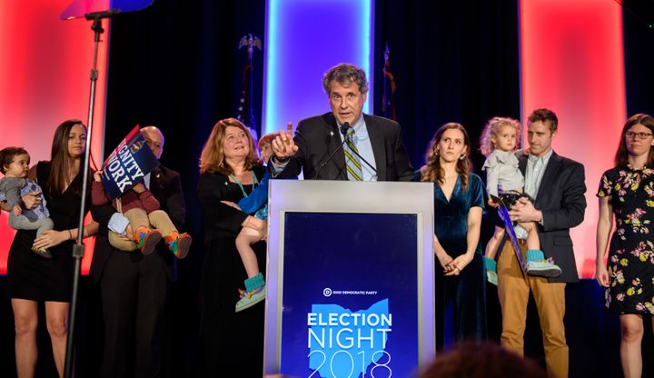 Brown, surrounded by members of his family, speaks in Columbus after his campaign victory.