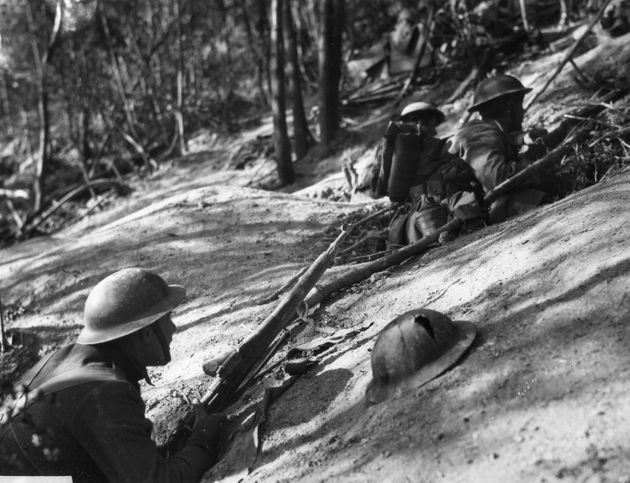 Close-up of American soldiers of the 18th Infantry, 1st Division holed up on the side of Hill 240 in...