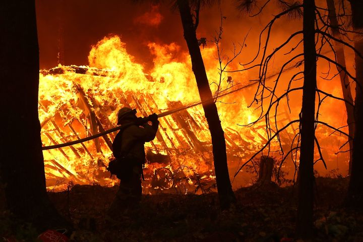 Firefighters work in dangerous conditions to fight the fast-moving fires in northern and southern California.