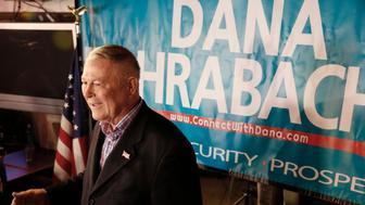 U.S. Rep. Dana Rohrabacher, R-Costa Mesa, addresses members of the media and supporters waiting for election results at the Skosh Monahan's Irish Pub in Costa Mesa, Calif., Tuesday, Nov. 6, 2018. Rohrabacher's opponent is Democrat Harley Rouda in Orange County's 48th District. (AP Photo/Damian Dovarganes)