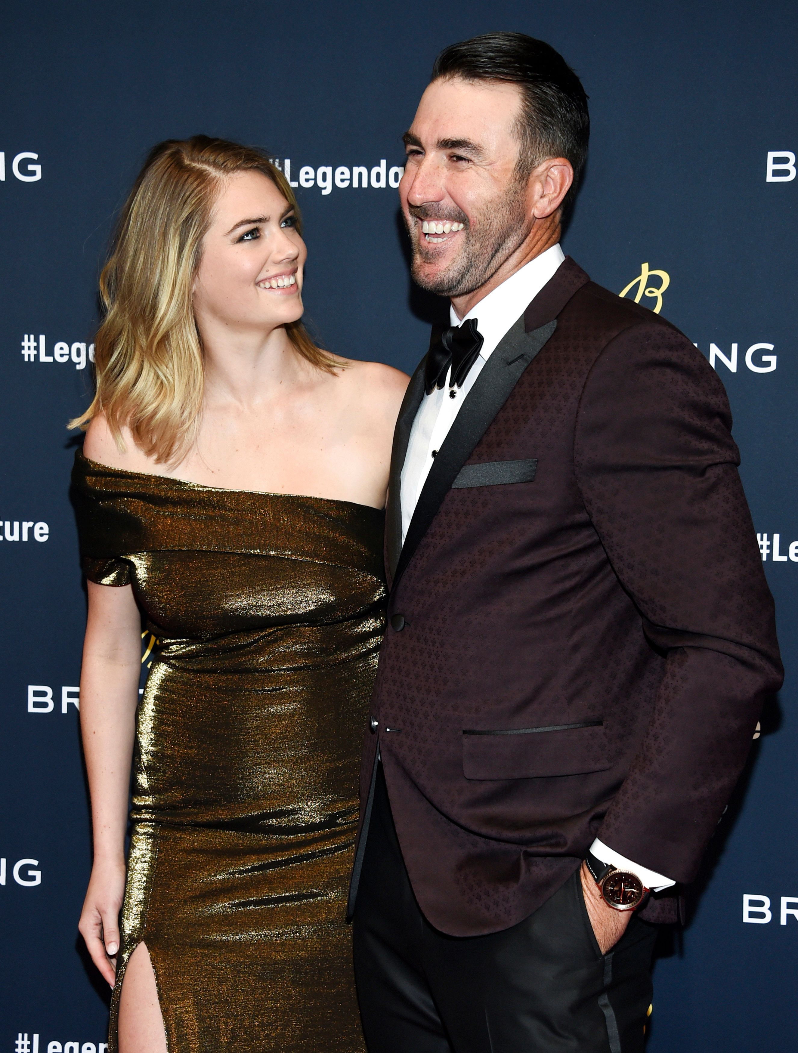 """FILE - In this Feb. 22, 2018, file photo, supermodel Kate Upton and husband professional baseball player Justin Verlander attend the Breitling Global Roadshow event at The Duggal Greenhouse in New York. Upton and Verlander are expecting their first child. Upton announced the pregnancy on Instagram on Saturday, July 14, 2018, in a post with the hashtag """"pregnant in Miami"""" where she tagged Verlander. (Photo by Evan Agostini/Invision/AP, Fileo"""