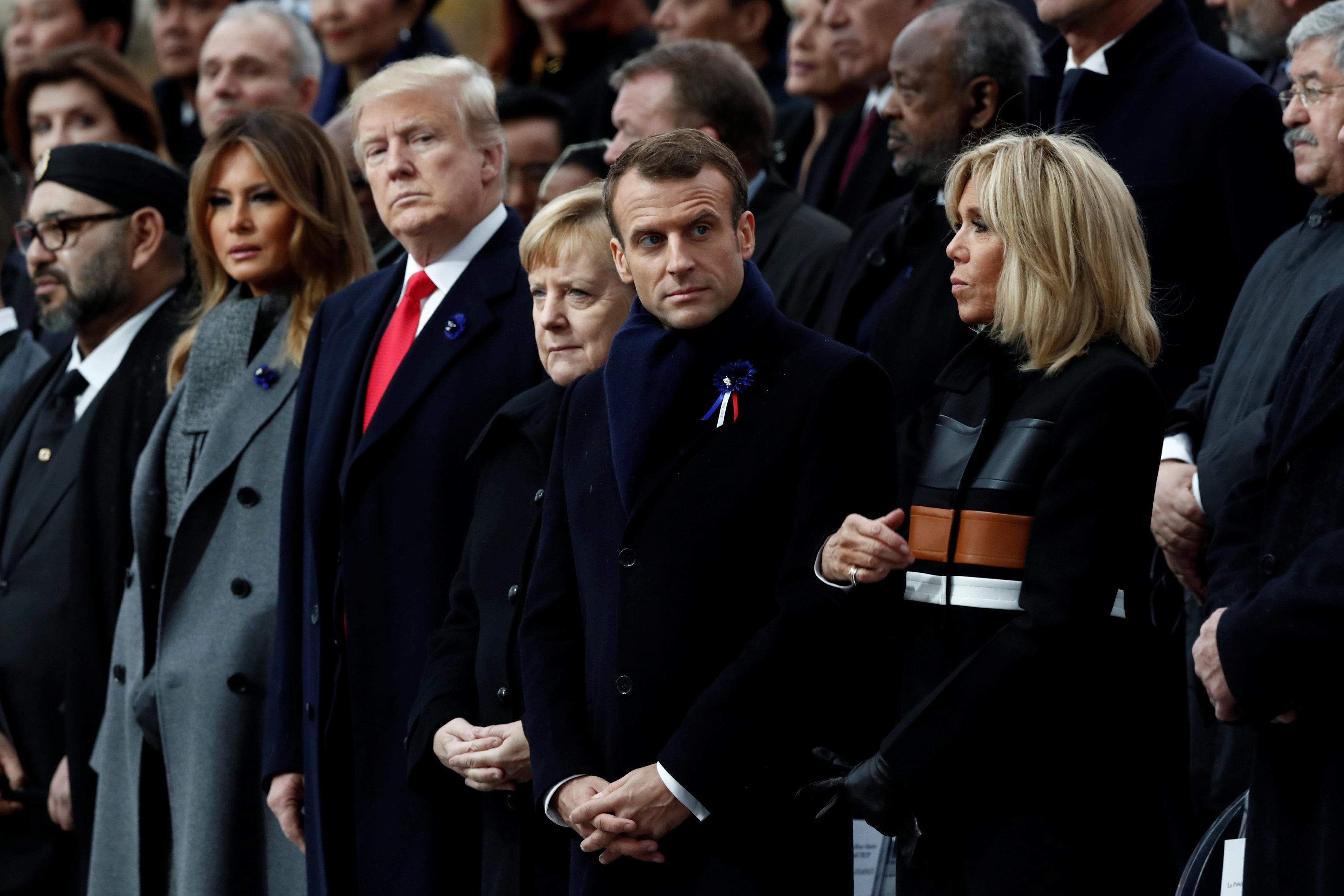U.S. President Donald Trump and first lady Melania Trump; German Chancellor Angela Merkel; andFrench President Emmanuel