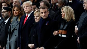 Brigitte Macron, French President Emmanuel Macron, German Chancellor Angela Merkel, U.S. President Donald Trump and first lady Melania Trump attend a commemoration ceremony for Armistice Day, 100 years after the end of the First World War at the Arc de Triomphe in Paris, France, November 11, 2018.  REUTERS/Benoit Tessier/Pool