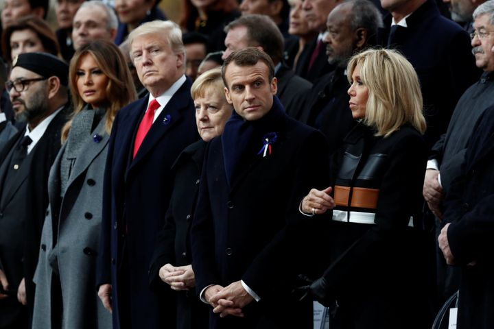 U.S. President Donald Trump and first lady Melania Trump; German Chancellor Angela Merkel; and French President Emmanuel