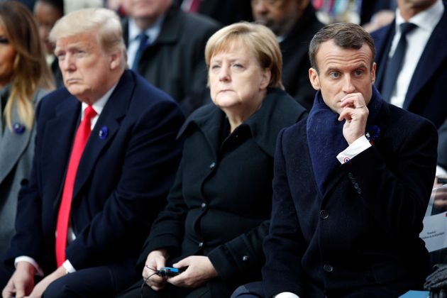 US President Donald Trump, left, German Chancellor Angela Merkel and French President Emmanuel Macron attend ceremonies at the Arc de Triomphe on Sunday.