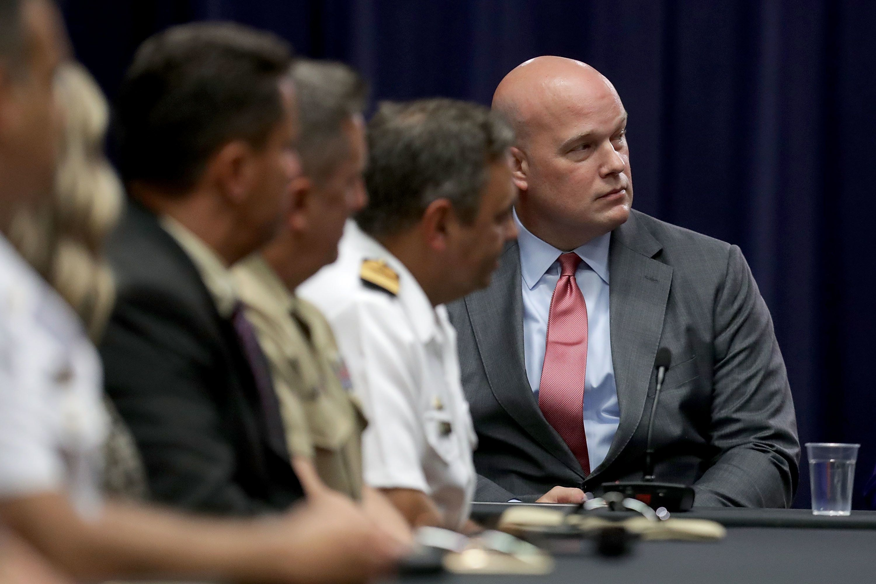 WASHINGTON, DC - AUGUST 29:  Department of Justice Chief of Staff Matt Whitaker (R) participates in a round table event with the Joint Interagency Task Force - South (JIATF-S) foreign liaison officers at the Department of Justice Kennedy building August 29, 2018 in Washington, DC. Based in Key West, Florida, the JIATF-S  is tasked with stopping the flow of illicit drugs with the cooperation of other agencies and international partners, including Brazil, Canada, Chile, Colombia, Dominican Republic, Ecuador, El Salvador, France, Honduras, Mexico, the Netherlands, Panama, Peru, Spain, Trinidad and Tobago and the United Kingdom.  (Photo by Chip Somodevilla/Getty Images)