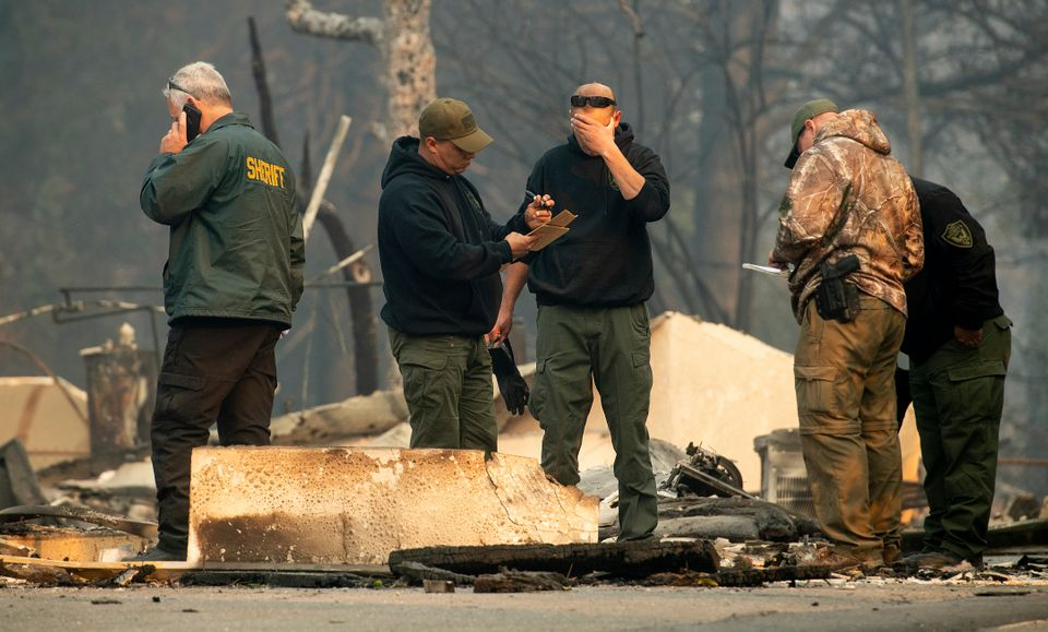 Sheriff's deputies recover the remains of Camp Fire victims on Saturday in Paradise,