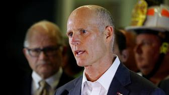 Florida Governor Rick Scott speaks to the media as rescue efforts continue after a pedestrian bridge collapsed at Florida International University in Miami, Florida, U.S., March 15, 2018.  REUTERS/Joe Skipper