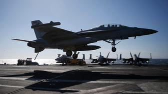 A U.S. Navy F/A-18 Super Hornet fighter lands onto the deck of the USS Ronald Reagan, a Nimitz-class nuclear-powered super carrier, during a joint naval drill between South Korea and the U.S. in the West Sea, South Korea, Wednesday, Oct. 28, 2015. (Kim Hong-Ji/Pool Photo via AP)
