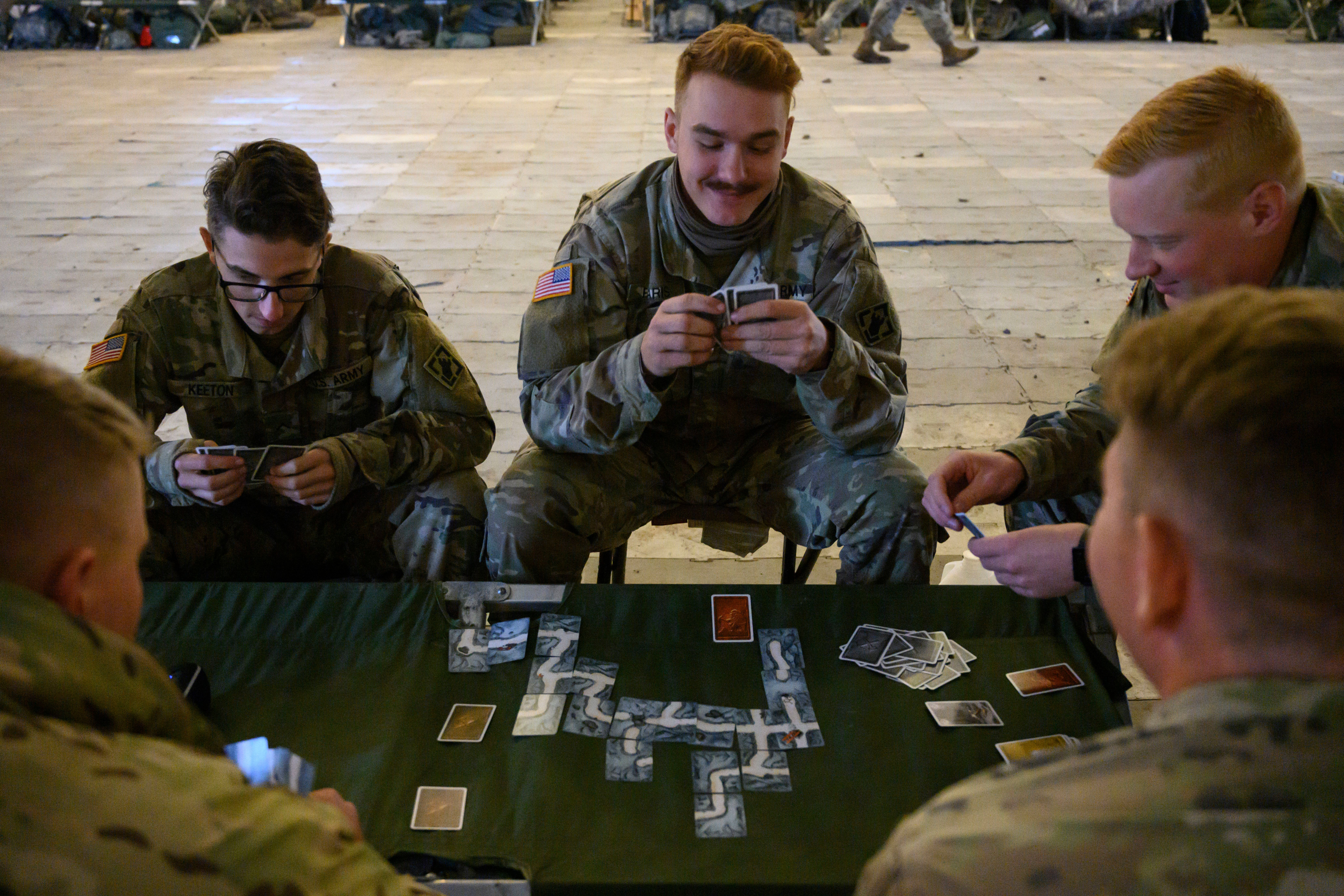 DONNA, TEXAS - NOVEMBER 10: Soldiers play cards in their tent at the military base camp Donna along the Mexican border in Donna, Texas on November 10, 2018. (Photo by Calla Kessler/The Washington Post via Getty Images)