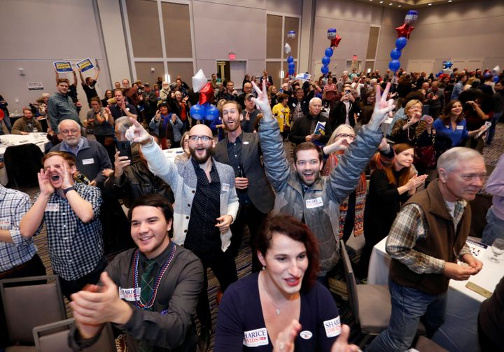 Supporters of Sharice Davids celebrate her victory over the Republican incumbent, Kevin Yoder, in their Kansas House race.