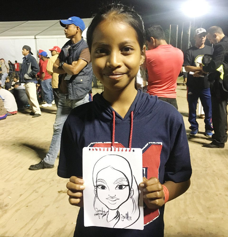 Sarahi, 8, is from Honduras and traveling with her family. She likes to draw and enjoys school. She says that the journey is