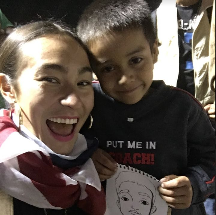 Artist Scarlett Baily in Mexico City with a child in the migrant caravan.