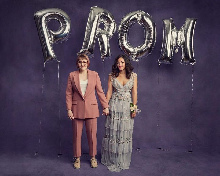 "In Broadway's ""The Prom,"" Caitlin Kinnunen and Isabelle McCalla portray a lesbian teen couple forbidden from attending their"