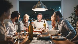 Closeup front view of a family having a Christmas breakfast. They are having some traditional roast, gravy and vegetables and also some vegetarian food. Right now they are toasting with wine. There are three generations at the table.