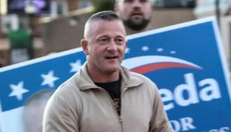 Democrat candidate for West Virginia's 3rd District Richard Ojeda marches in the homecoming parade for Marshall University in Huntington, West Virginia, on October 18, 2018. - Richard Ojeda is not a typical Democratic congressional candidate, the heavily tattooed Army veteran stomps around southwestern West Virginia in tight Grunt Style t-shirts, tactical pants and combat boots. (Photo by Michael Mathes / AFP)        (Photo credit should read MICHAEL MATHES/AFP/Getty Images)