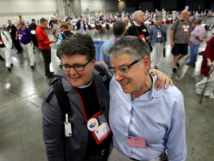 The Rev. Cynthia Black (left), and her spouse, Becky Walker,speak with a reporter after Episcopalians voted to allow re