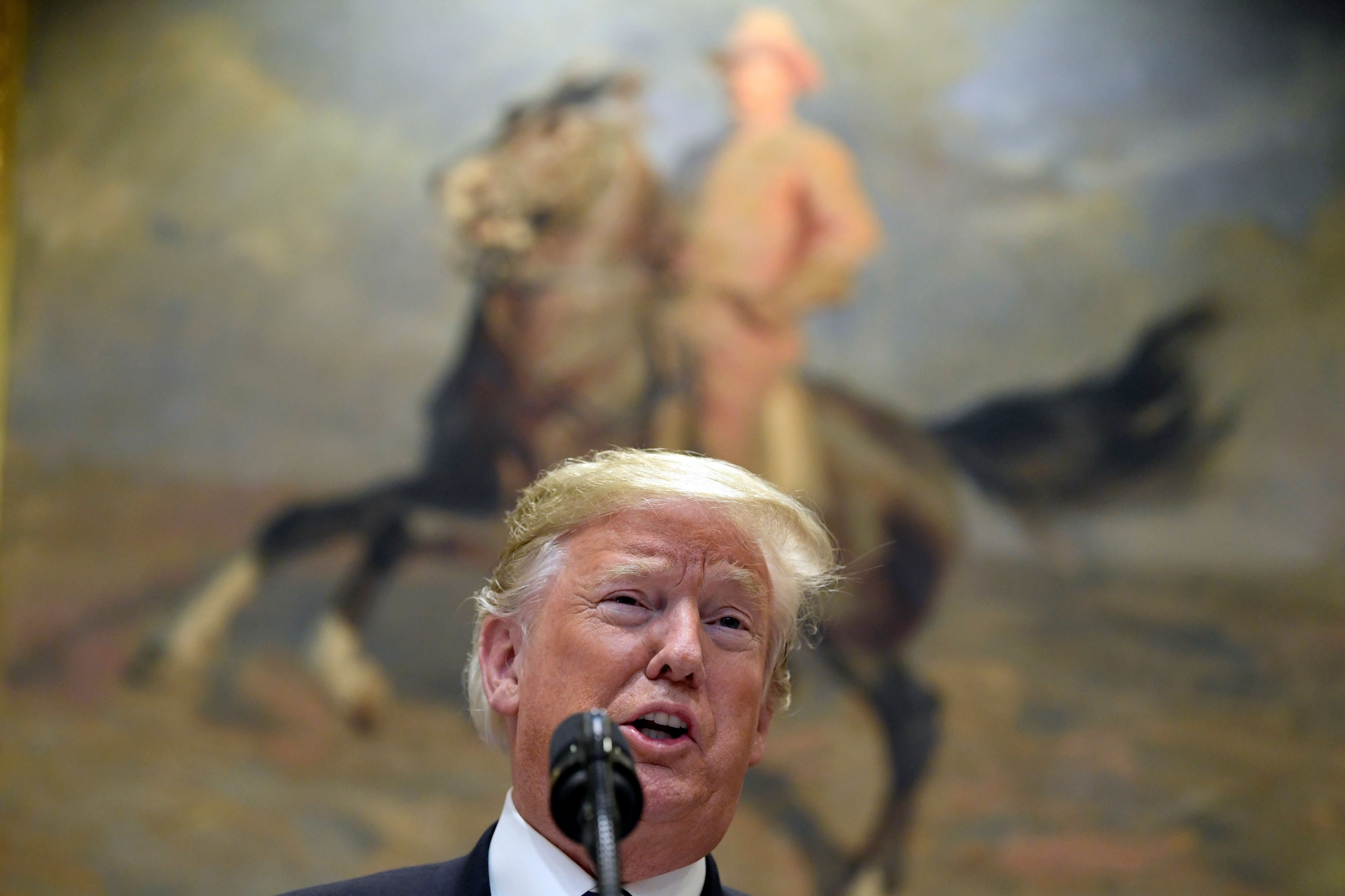 President Donald Trump talks about immigration and gives an update on border security from the Roosevelt Room of the White House in Washington, Thursday, Nov. 1, 2018. Trump says asylum seekers must go to ports of entry in order to make a claim. He says he will issue an executive order next week on immigration. (AP Photo/Susan Walsh)