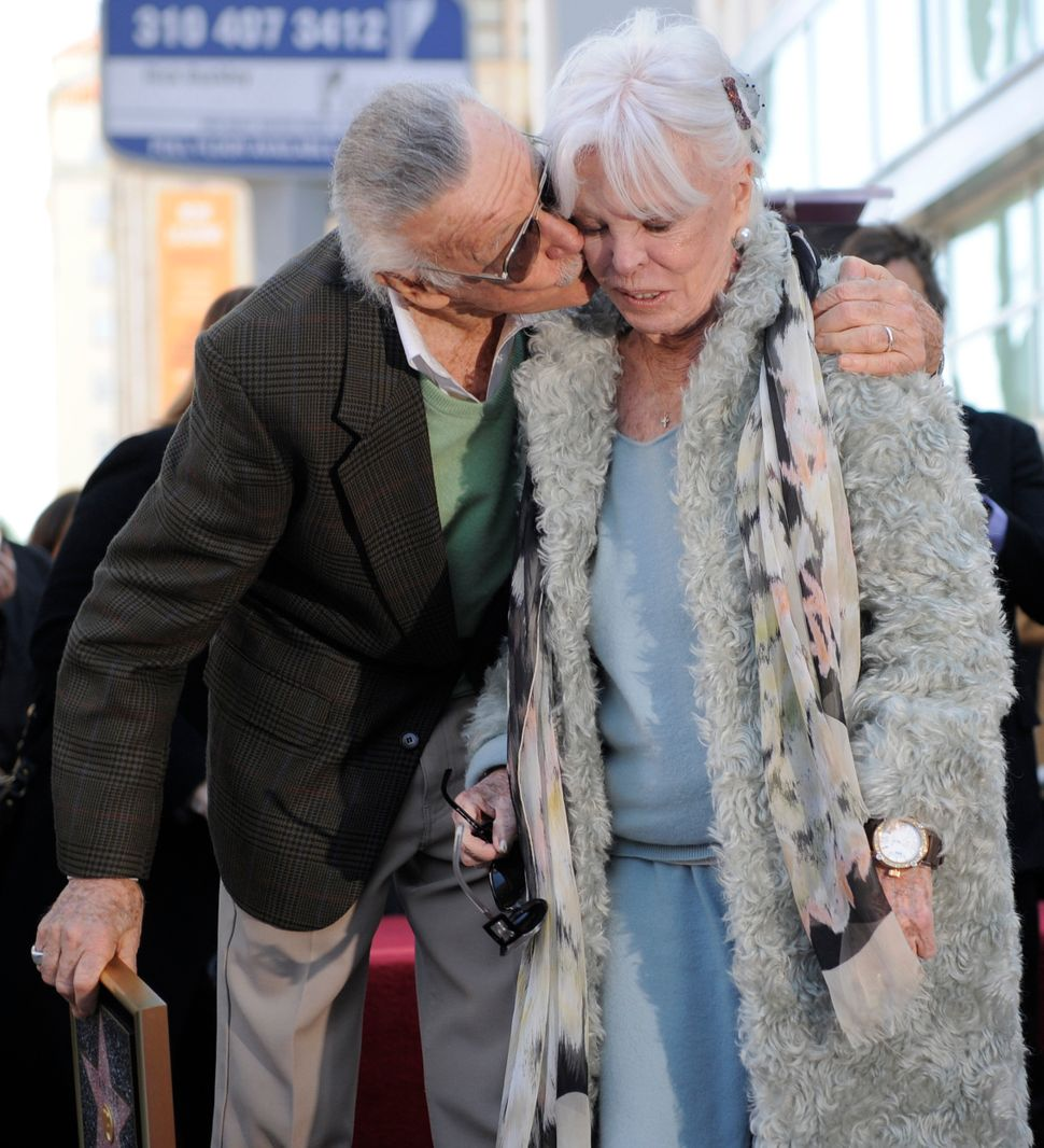Comic book creator Stan Lee gives his wife, Joan, a kiss after he received a star on the Hollywood Walk of Fame on Jan. 4, 20
