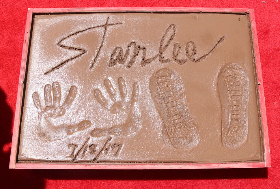 Stan Lee places his feet and hands in cement at the TCL Chinese Theatre on July 18, 2017, in Hollywood.