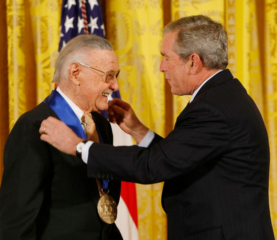 President George W. Bush presents the 2008 National Medals of Arts to comic book creator Stan Lee on Nov. 17, 2008, in the Ea