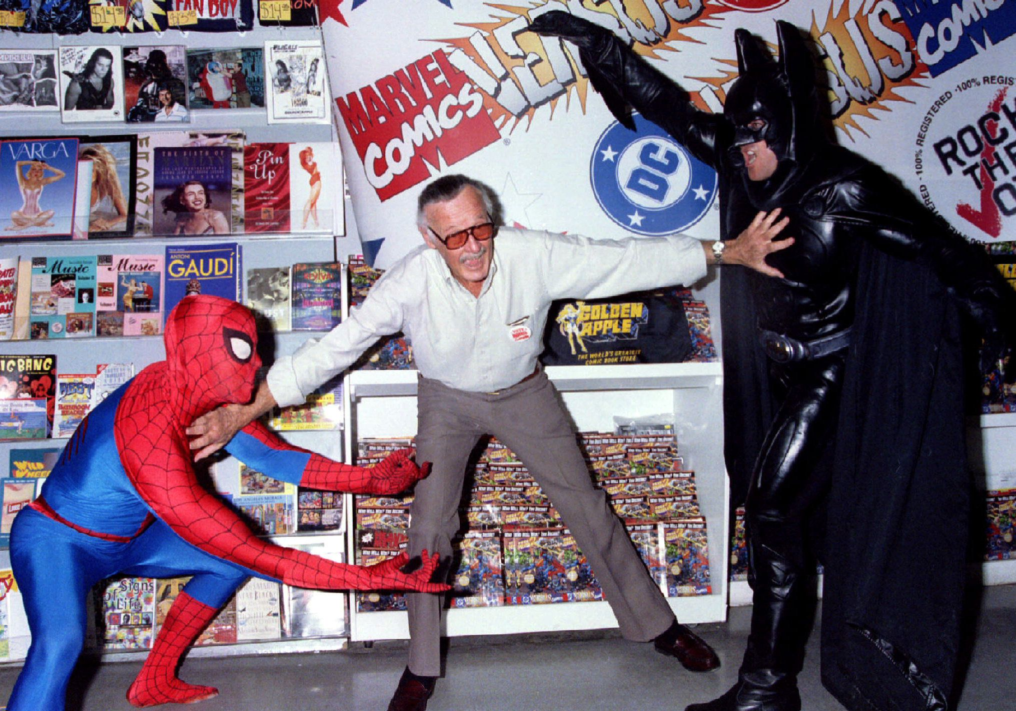 Stan Lee, comic book character creator for Marvel Comics, breaks up a fight between comic characters Spiderman (L) and Batman during a promotion November 8 at The Golden Apple comic book  store. The superheroes battle each other in a special comic book series issued  by DC and Marvel Comics