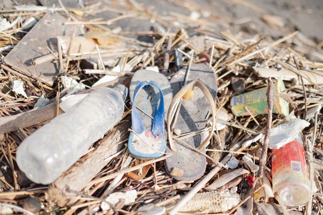 Flip-flops, water bottles and other rubbish litter a beach in Sanur on the island of Bali in