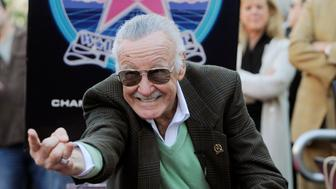 "Comic book creator Stan Lee strikes the ""Spiderman"" pose after he received  a star on the Hollywood Walk of Fame in Los Angeles, Tuesday, Jan. 4, 2011. (AP Photo/Chris Pizzello)"