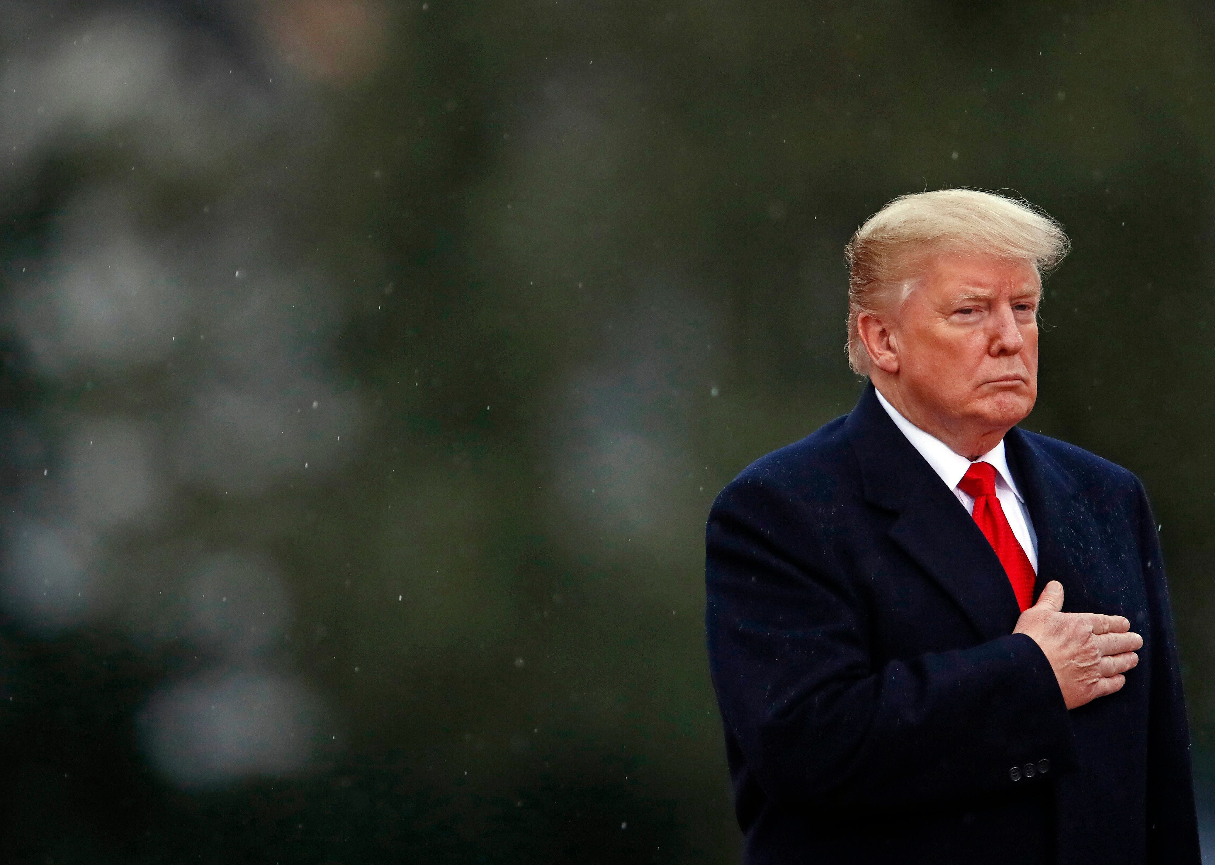 U.S. President Donald Trump visits the Suresnes American Cemetery, near Paris, as part of the Paris commemoration ceremony for Armistice Day, 100 years after the end of the First World War, France, Sunday, Nov. 11, 2018. (Christian Hartmann/Pool Photo via AP)