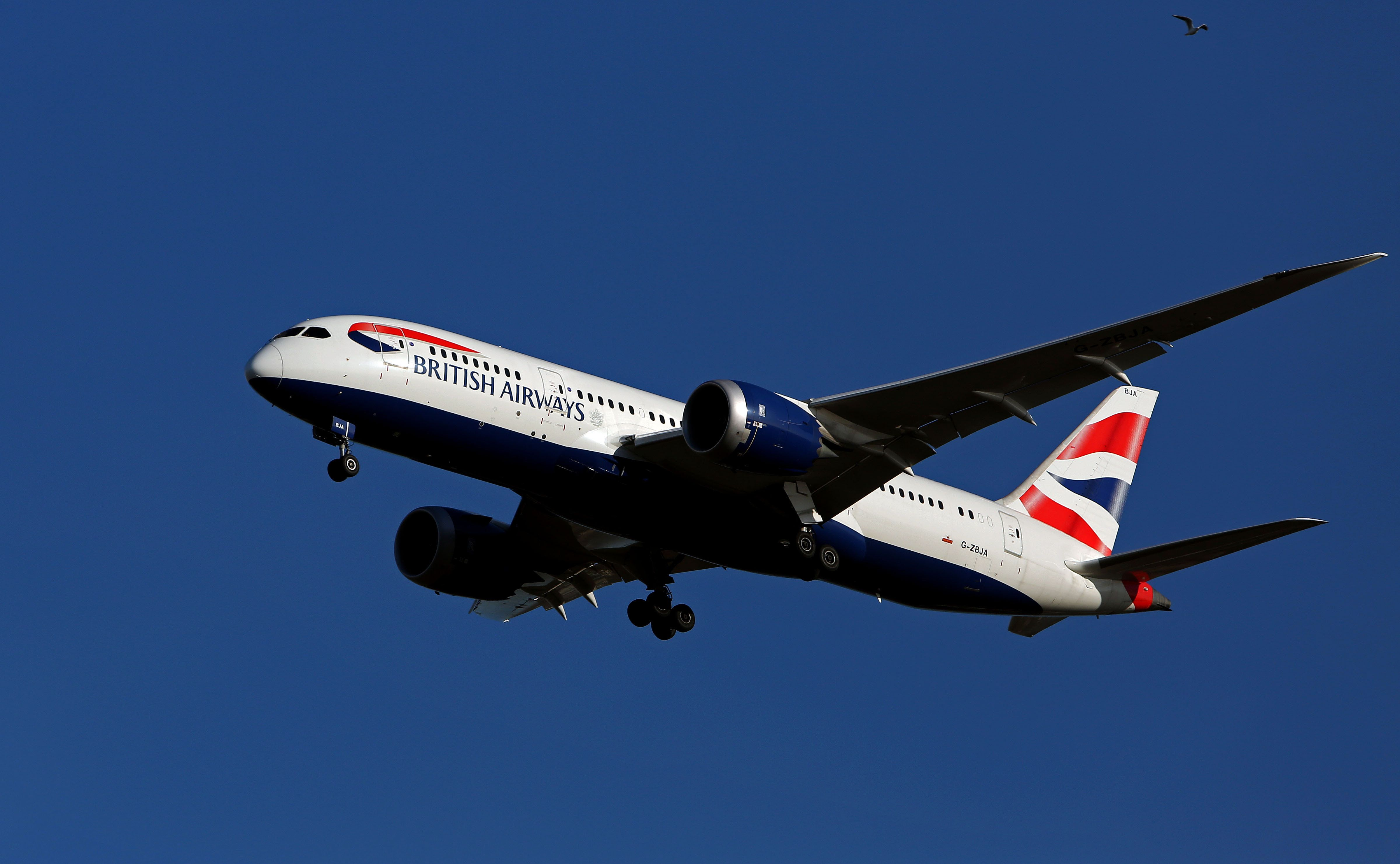 A British Airways Boeing 787-8 Dreamliner plane with the registration G-ZBJA lands at Heathrow