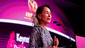 Myanmar's leader Aung San Suu Kyi delivers the keynote speech at the ASEAN Business and Investment Summit 2018, a parallel summit in the ongoing ASEAN Summit 2018 in Singapore, Monday, Nov. 12, 2018. Twenty heads of states are gathering in Singapore for the Summit. (AP Photo/Bullit Marquez)