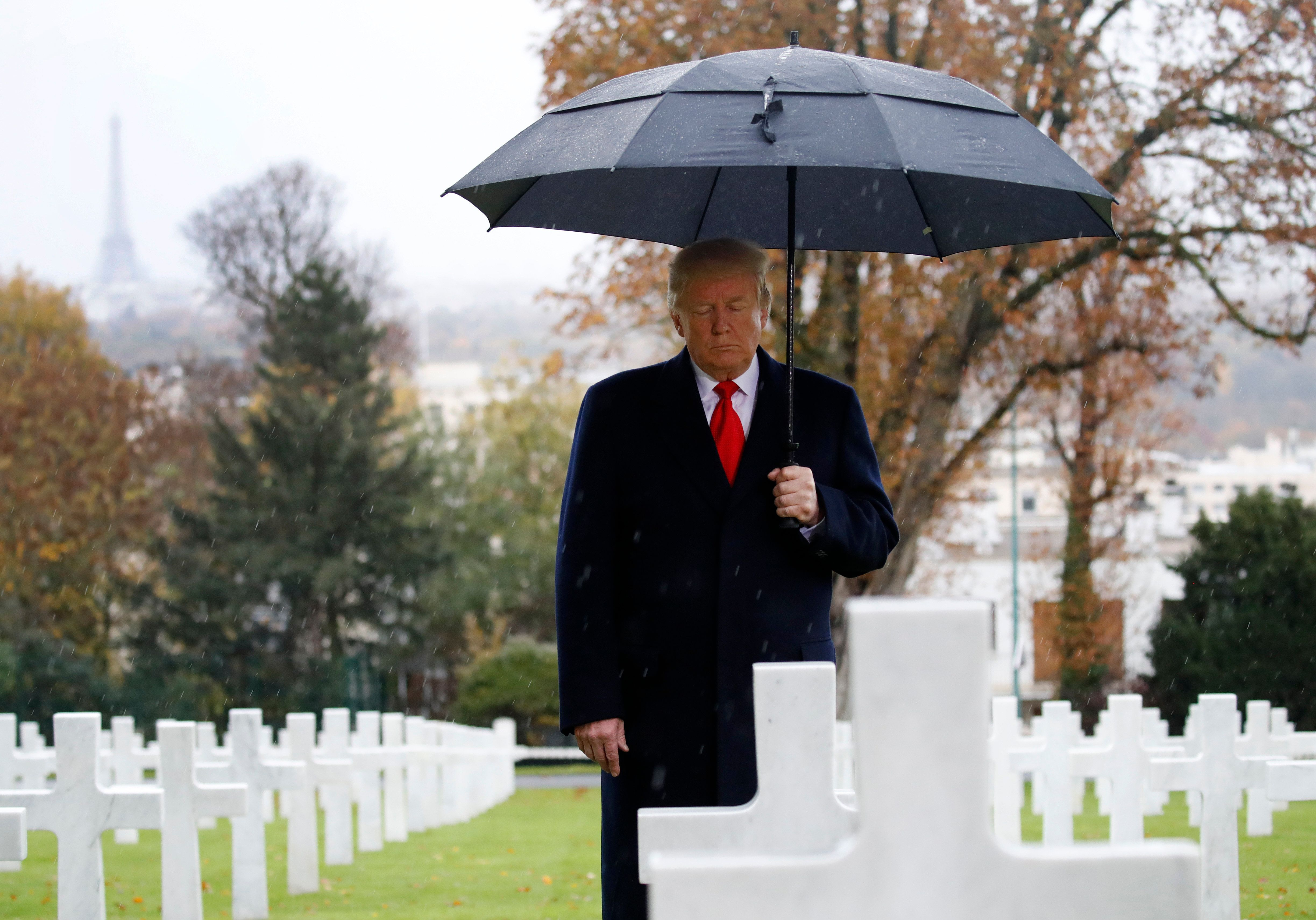 President Donald Trump stands amongst the headstones during an American Commemoration Ceremony, Sunday Nov. 11, 2018, at Suresnes American Cemetery near Paris. Trump is attending centennial commemorations in Paris this weekend to mark the Armistice that ended World War I. (AP Photo/Jacquelyn Martin)
