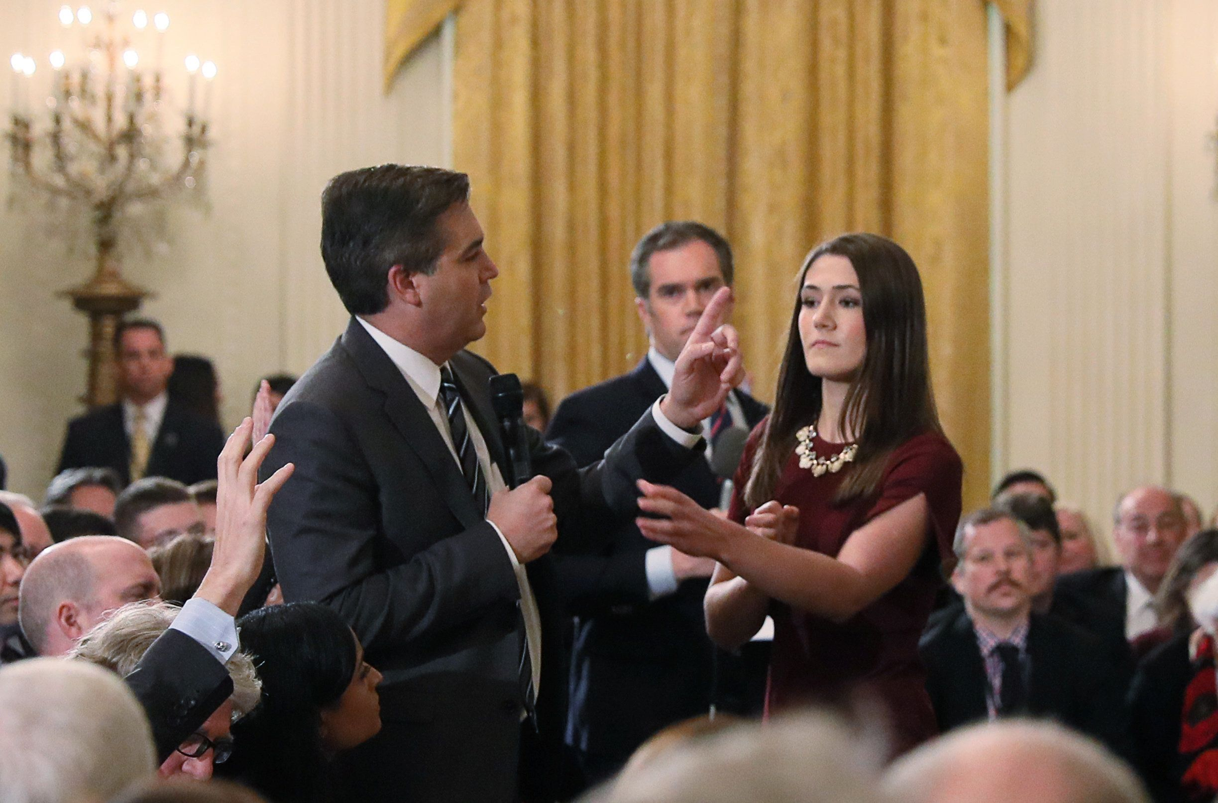 A White House intern reaches for and tries to take away the microphone held by CNN correspondent Jim Acosta as he questions U.S. President Donald Trump during a news conference at the White House in Washington, U.S., November 7, 2018. Picture taken November 7, 2018. REUTERS/Jonathan Ernst  (Picture 7 in a sequence of 15)