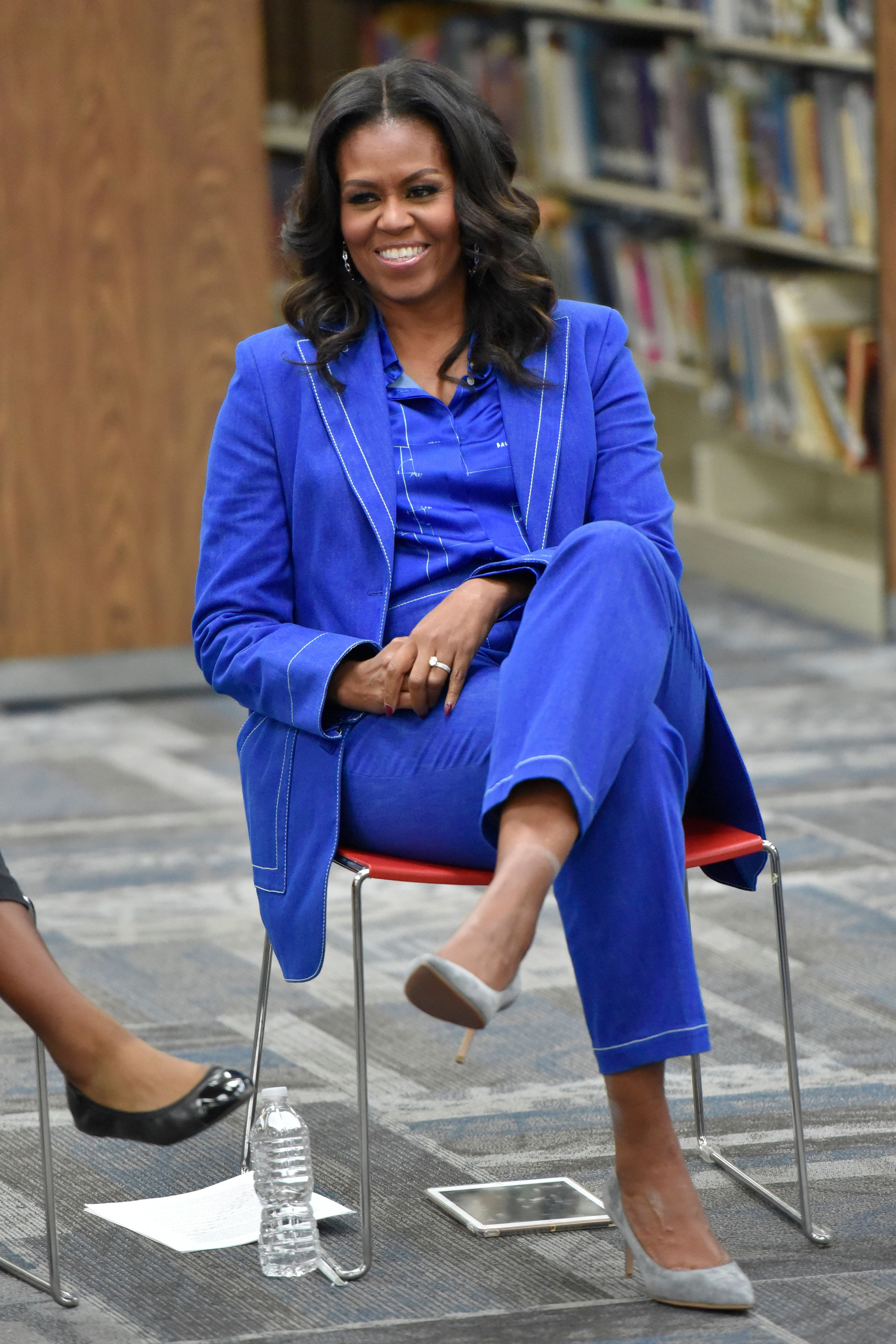 "Former first lady Michelle Obama speaks with students about her upcoming book ""Becoming"" during a roundtable discussion at Whitney M. Young Magnet High School, on Monday, Nov. 12, 2018, in Chicago. (Photo by Rob Grabowski/Invision/AP)"