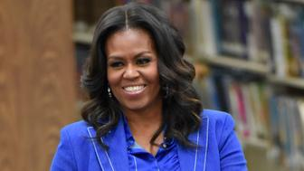 """Former first lady Michelle Obama speaks with students about her upcoming book """"Becoming"""" during a roundtable discussion at Whitney M. Young Magnet High School, on Monday, Nov. 12, 2018, in Chicago. (Photo by Rob Grabowski/Invision/AP)"""