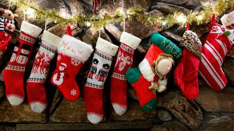 ORANGE, CA - DECEMBER 21: Braun family stockings hang above the fireplace.    ///ADDITIONAL INFORMATION: santabob.1224 Ð 12/21/15 Ð LEONARD ORTIZ, ORANGE COUNTY REGISTER - _DSC7263.NEF - A 'Clark Griswald' type who goes crazy decorating the inside and outside of his home in Orange was too depressed to decorate this year after his wife, Janet, died in August. But Bob Braun, also known as 'Santa Bob', decided to decorate in honor of his wife after an output of support from the community. (Photo by Leonard Ortiz/Digital First Media/Orange County Register via Getty Images)