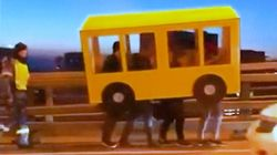 Four Guys Dress As A Bus To Cross Vehicle-Only Bridge In