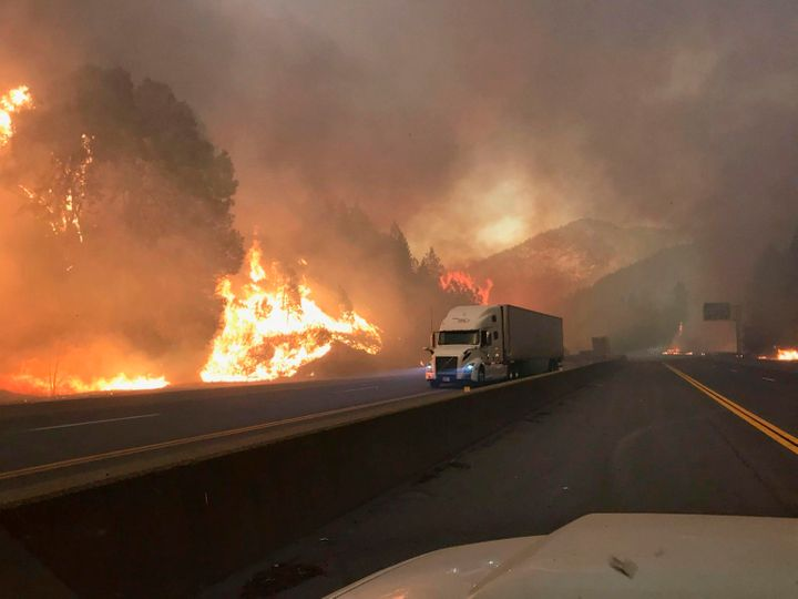 A truck drives next to the Delta fire along Interstate 5 near Shasta-Trinity National Forest, California, on Sept. 5, 20