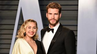 BEVERLY HILLS, CA - MARCH 04:  Miley Cyrus and Liam Hemsworth attend the 2018 Vanity Fair Oscar Party Hosted By Radhika Jones - Arrivals at Wallis Annenberg Center for the Performing Arts on March 4, 2018 in Beverly Hills, CA.  (Photo by Presley Ann/Patrick McMullan via Getty Images)