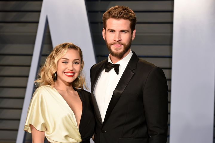 Miley Cyrus and Liam Hemsworth attend the 2018 Vanity Fair Oscar party on March 4 in Beverly Hills, CA.