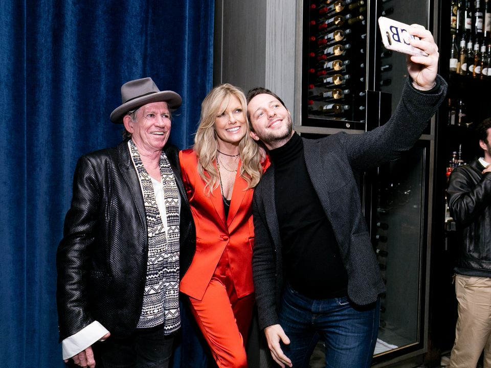 "NEW YORK, NY - NOVEMBER 12: (L-R) Keith Richards, Patti Hansen and Derek Blasberg pose at the launch of ""Patti Hansen: A Port"