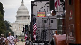 The U.S. Capitol stands past long-haul trucks parked on the National Mall during the Ten Four DC event in Washington, D.C., U.S., on Thursday, Oct. 4, 2018. The event is intended to improve safety and training standards across the trucking industry and lead engagement to help eliminate the fourteen-hour rule. Photographer: Andrew Harrer/Bloomberg via Getty Images