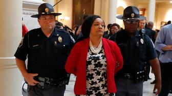 Sen. Nikema Williams (D-Atlanta) is arrested by capitol police during a protest over election ballot counts in the rotunda of the state capitol building Tuesday, Nov. 13, 2018, in Atlanta. (AP Photo/John Bazemore)