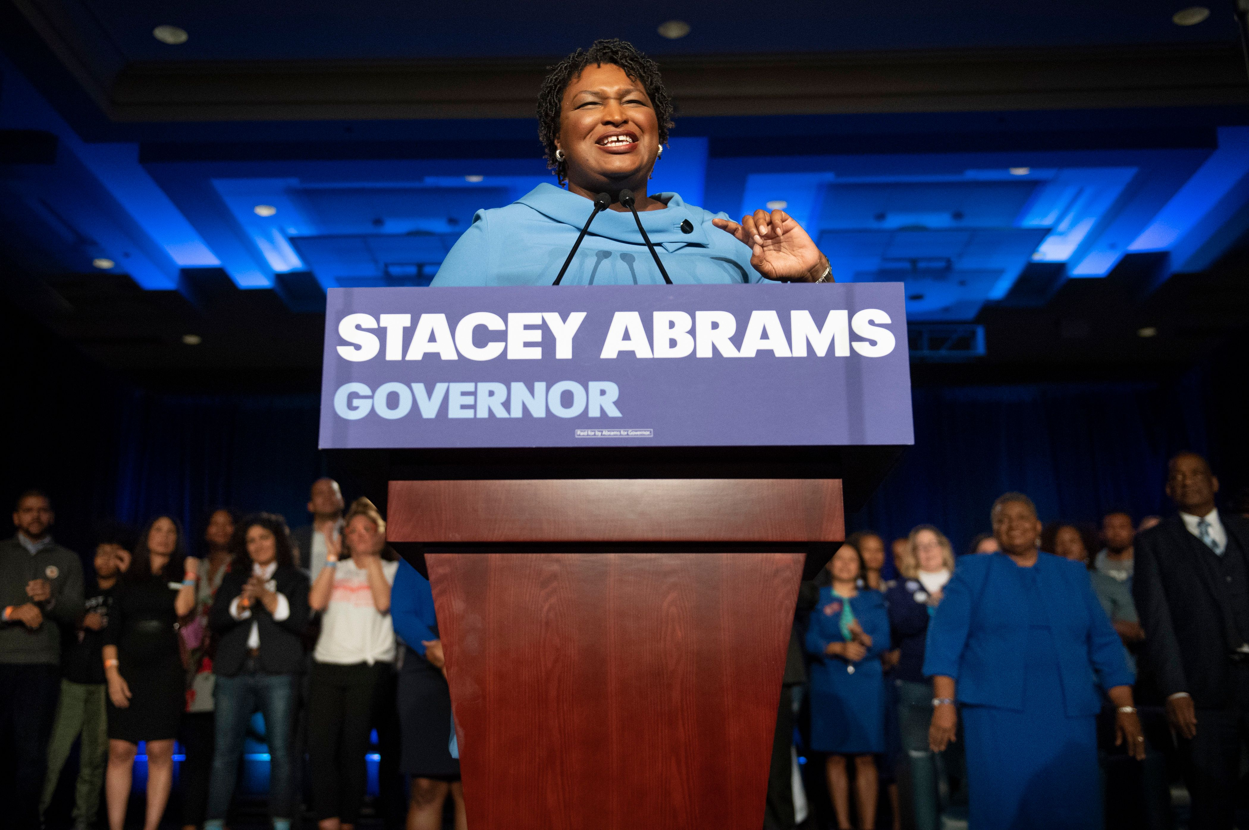 Georgia Democratic gubernatorial candidate Stacey Abrams speaks to supporters about her expectations of a run-off during an election night watch party, Tuesday, Nov. 6, 2018, in Atlanta. Abrams, the first black woman to be a major party nominee for governor in the United States, faced Republican challenger Georgia Secretary of State Brian Kemp. (AP Photo/John Amis)