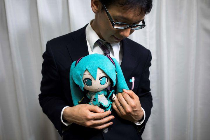 Groom Akihiko Kondo, 35, with a Hatsune Miku stuffed doll at the wedding.